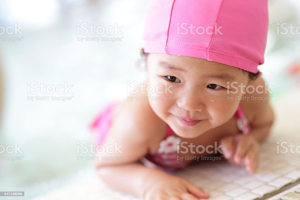 girl wear swimsuit play happily stock photo