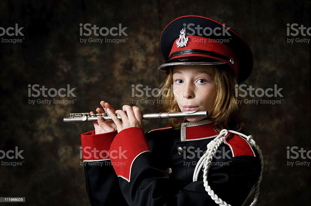 girl wearing a band uniform playing piccolo stock photo