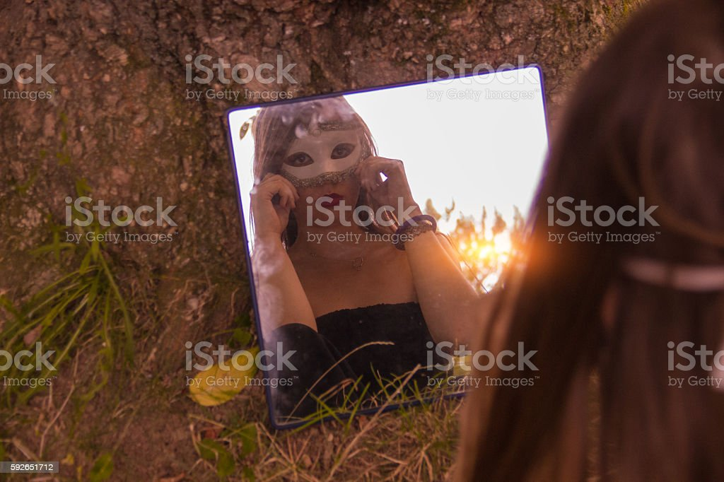Girl wearing a mask royalty-free stock photo