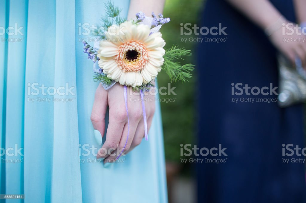 Girl wearing a powder blue dress with a corsage stock photo