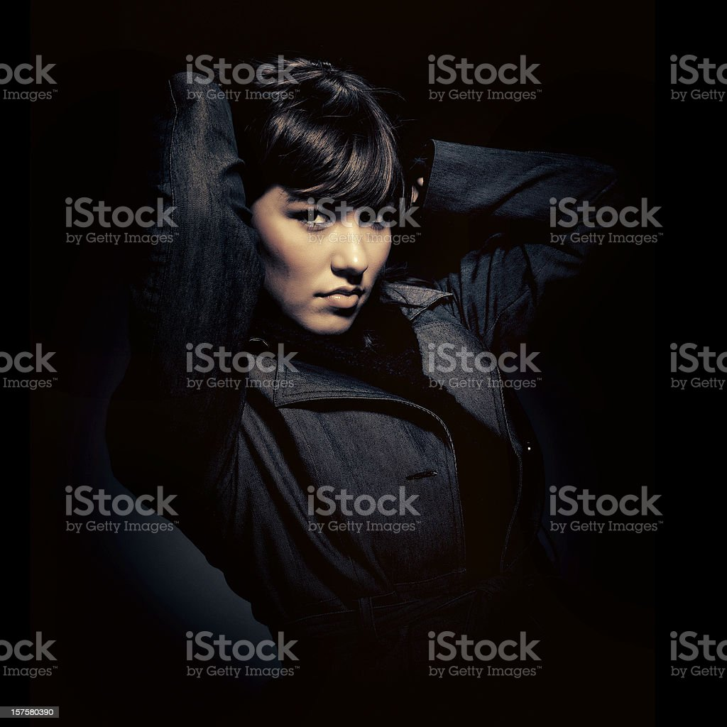 girl wearing black gabardine staring at camera stock photo