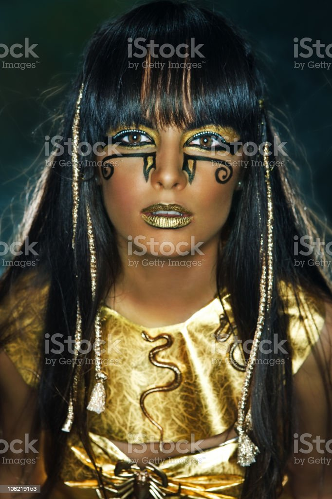 Girl Wearing Gold Costume and Face Painted Make-Up royalty-free stock photo
