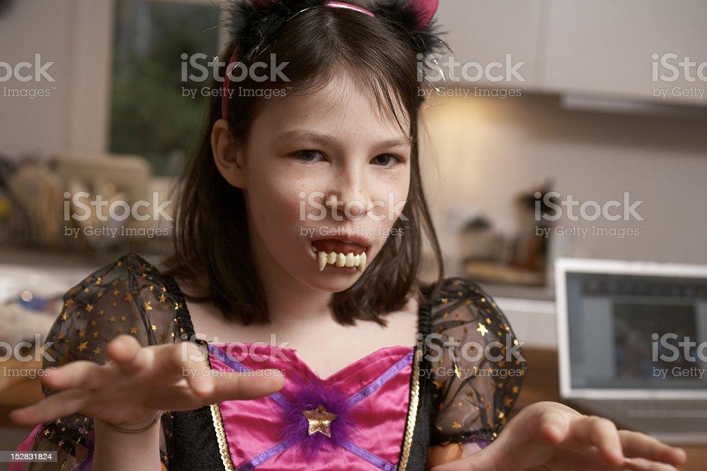 Girl wearing Halloween costume stock photo