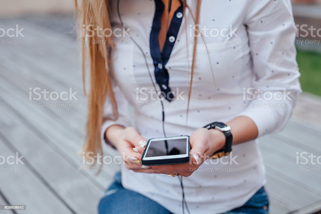 Girl wearing headphones and listening to music. Close up. stock photo
