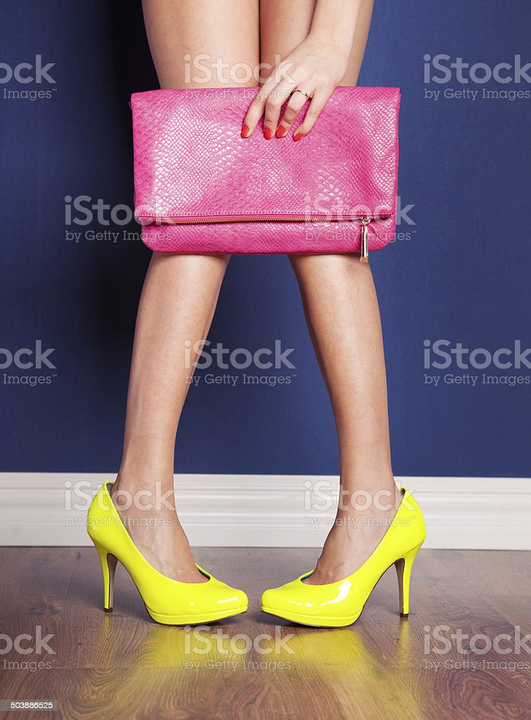 Girl wearing high heels and holding a bag stock photo