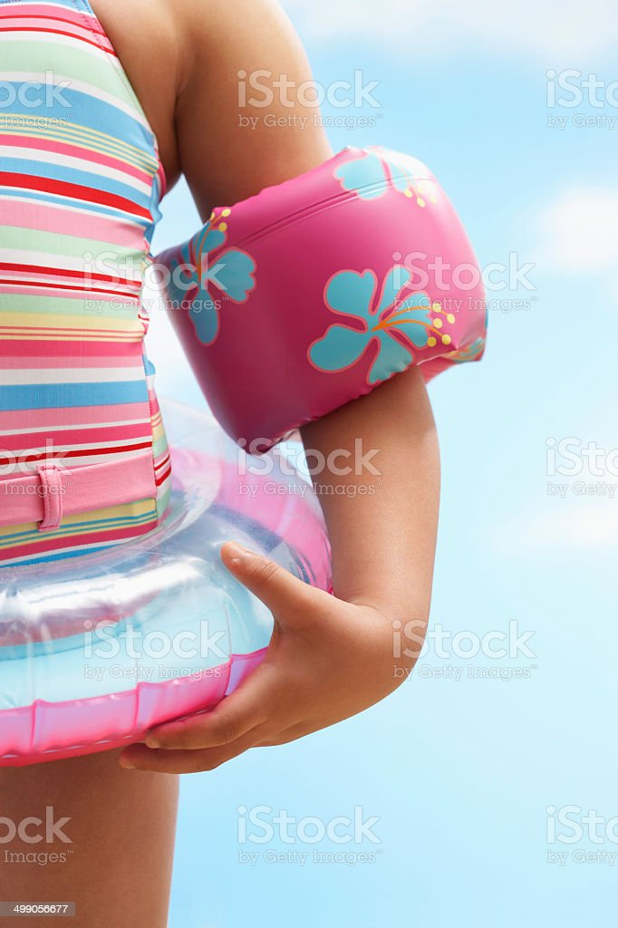 Girl Wearing Inflatable Ring And Water Wings stock photo