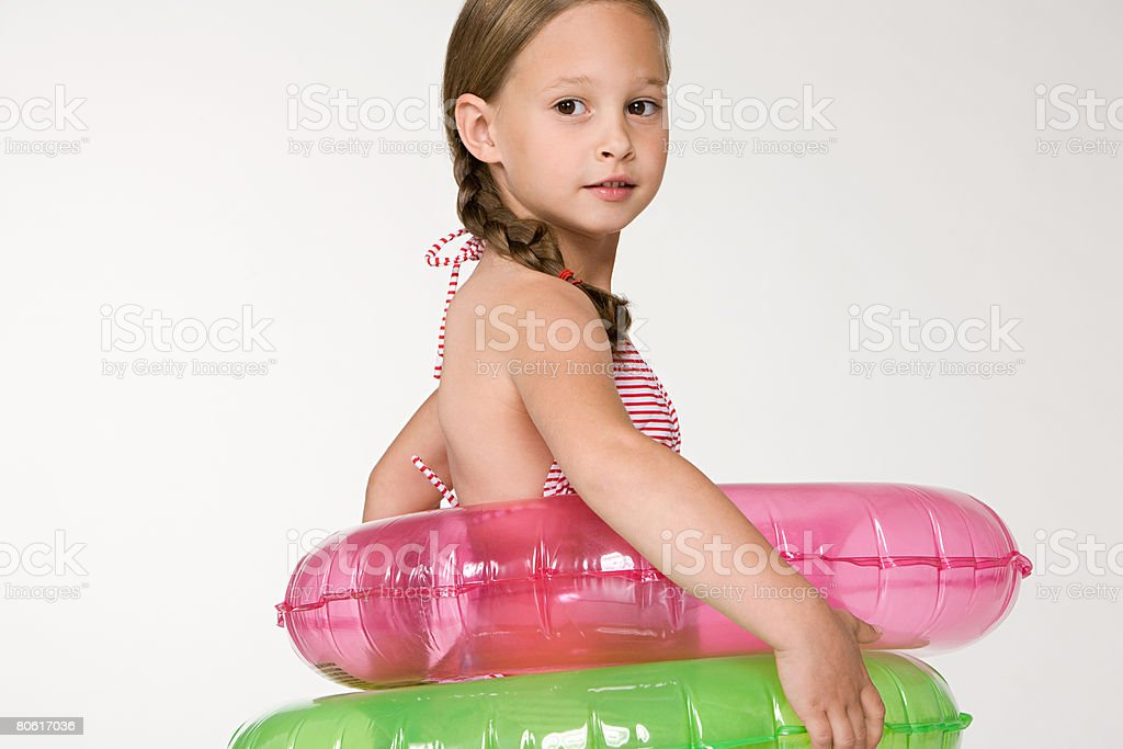 A girl wearing inflatable rings royalty-free stock photo
