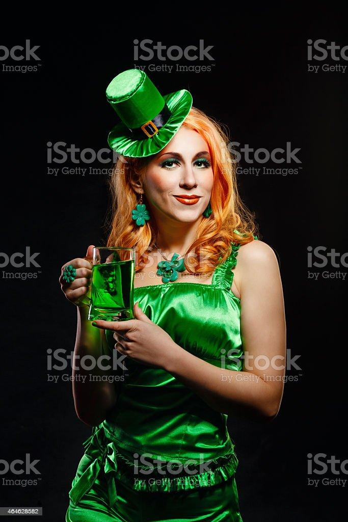 Girl wearing leprechaun stock photo
