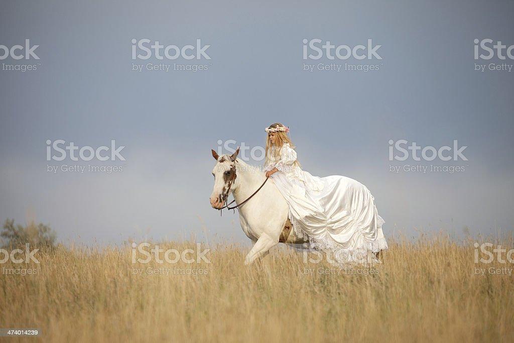 Girl Wearing Long White Dress Costume Riding Horse royalty-free stock photo