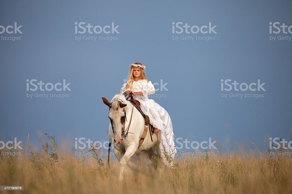 Girl Wearing Long White Dress Riding Horse royalty-free stock photo