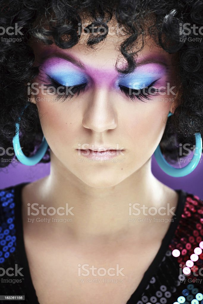 Girl wearing makeup with eyes closed royalty-free stock photo