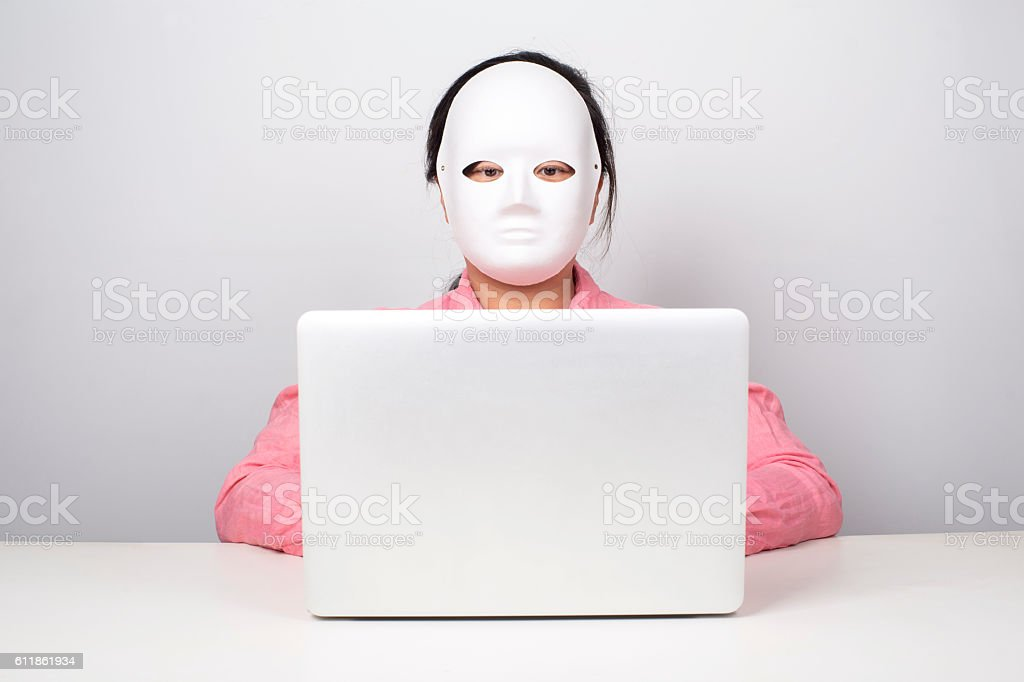 girl wearing mask working on laptop stock photo