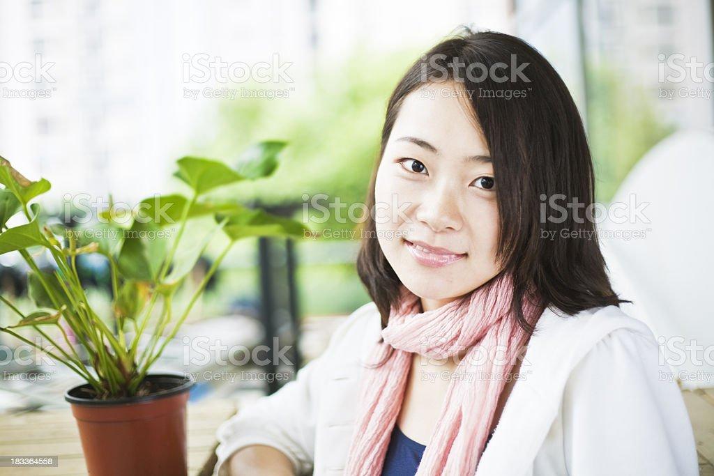 Girl wearing pink scarf royalty-free stock photo