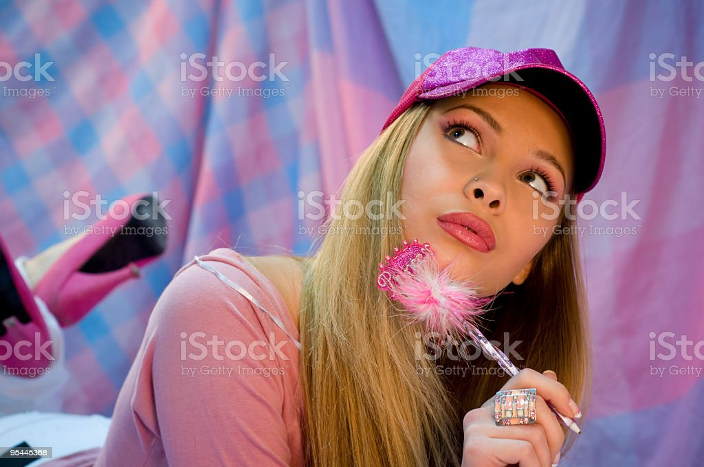 Girl wearing pink writing a letter stock photo