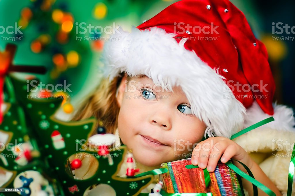 Girl wearing Santa hat at Christmas time royalty-free stock photo