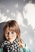 Girl wearing skull-pattern scarf