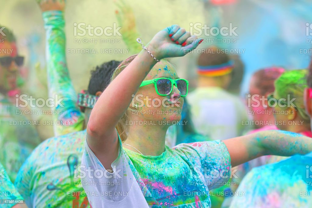 Girl wearing sun glasses waiving the arms in the sky stock photo