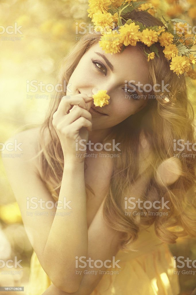 girl wearing yellow flower wreath stock photo