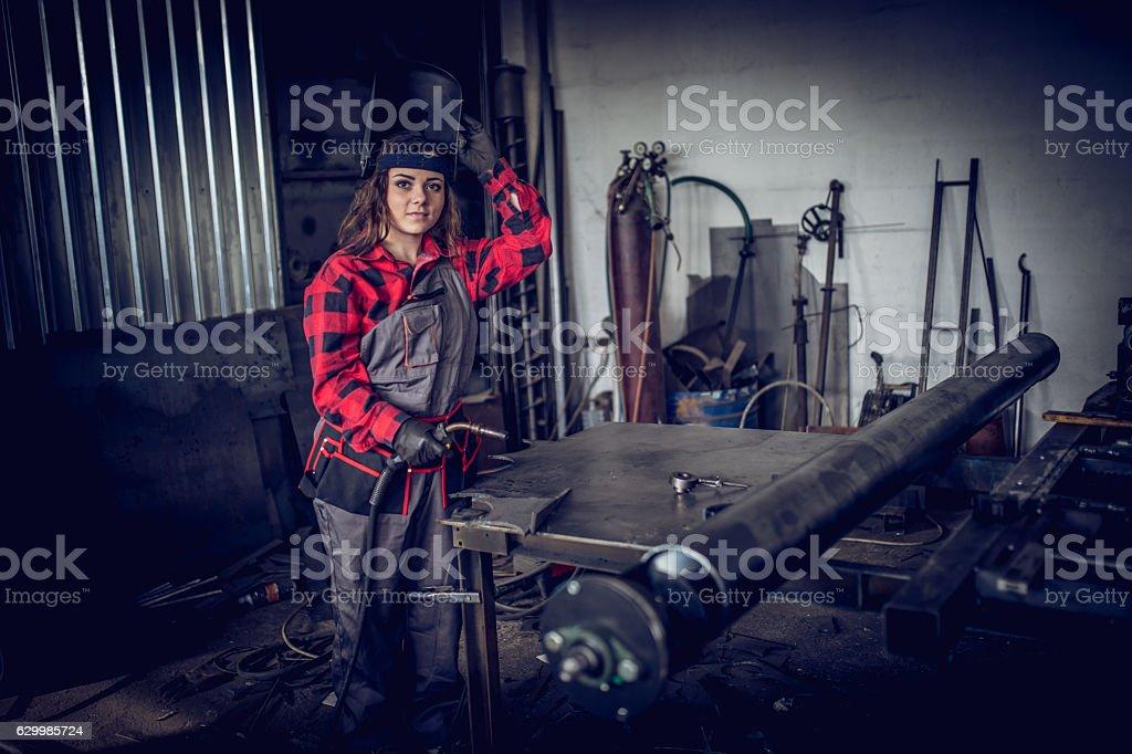 Girl welder in workshop stock photo