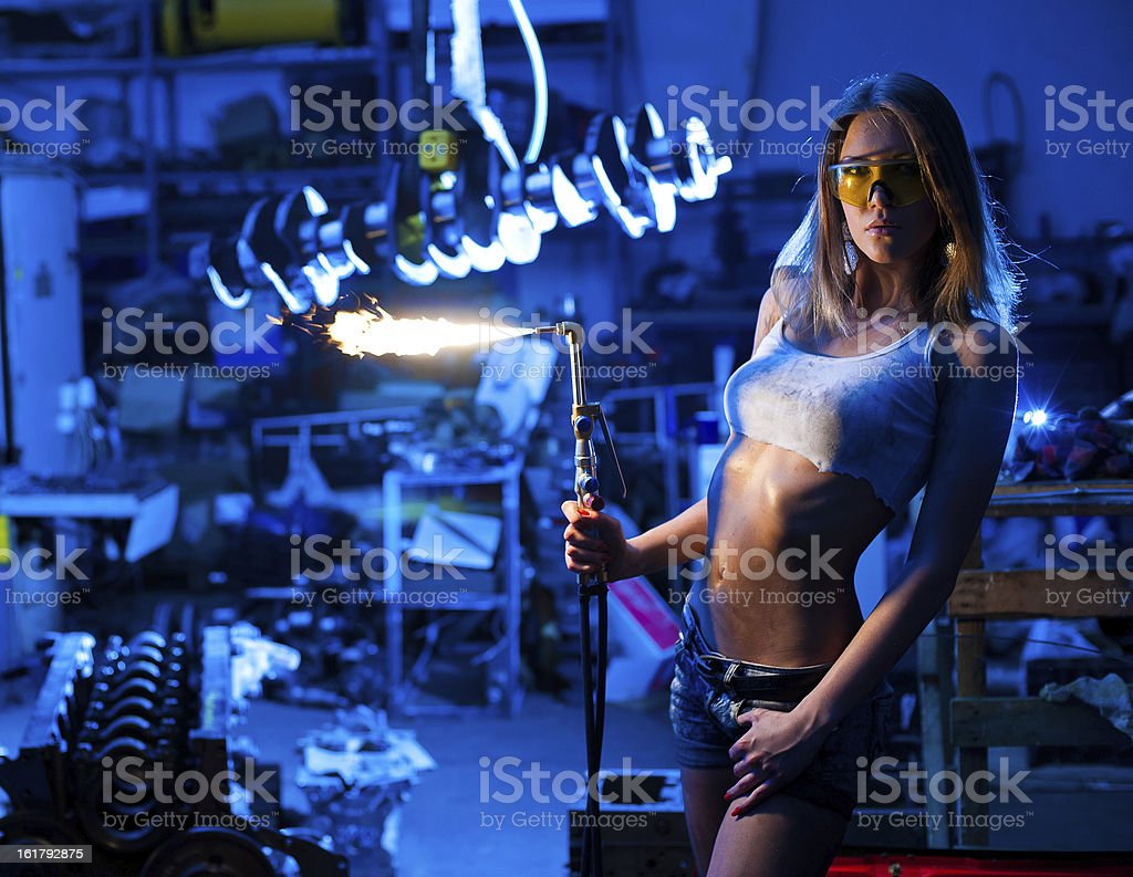 Girl welder stock photo