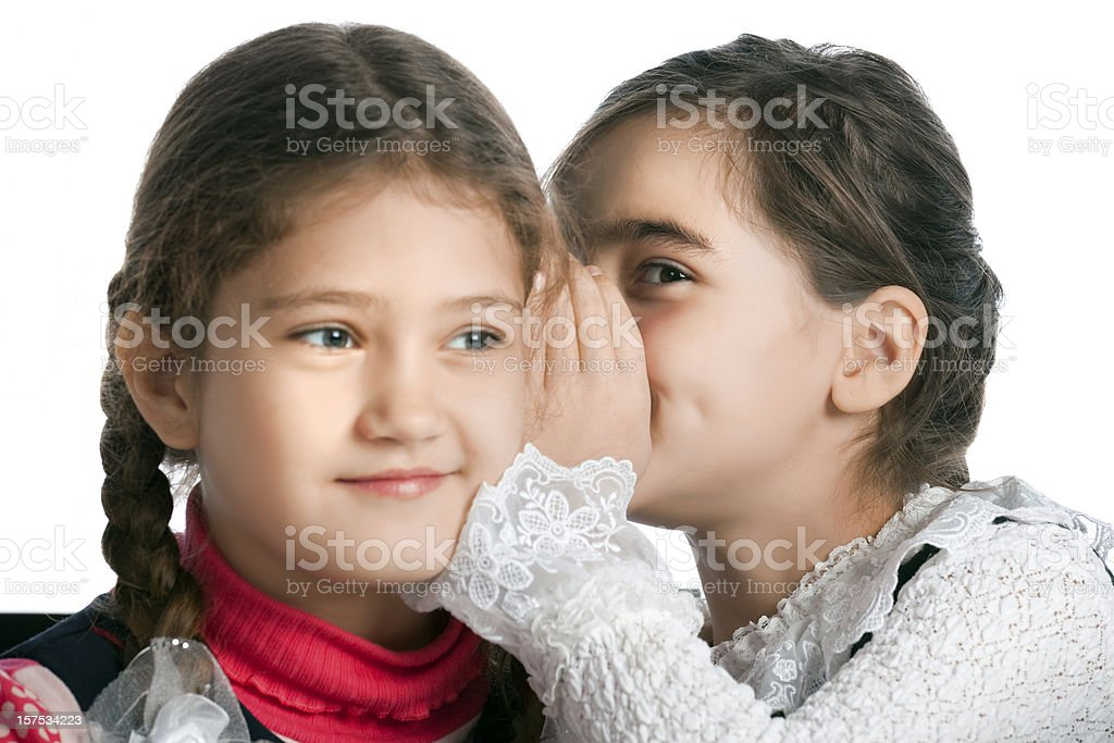Girl whispering the secret with her friend royalty-free stock photo