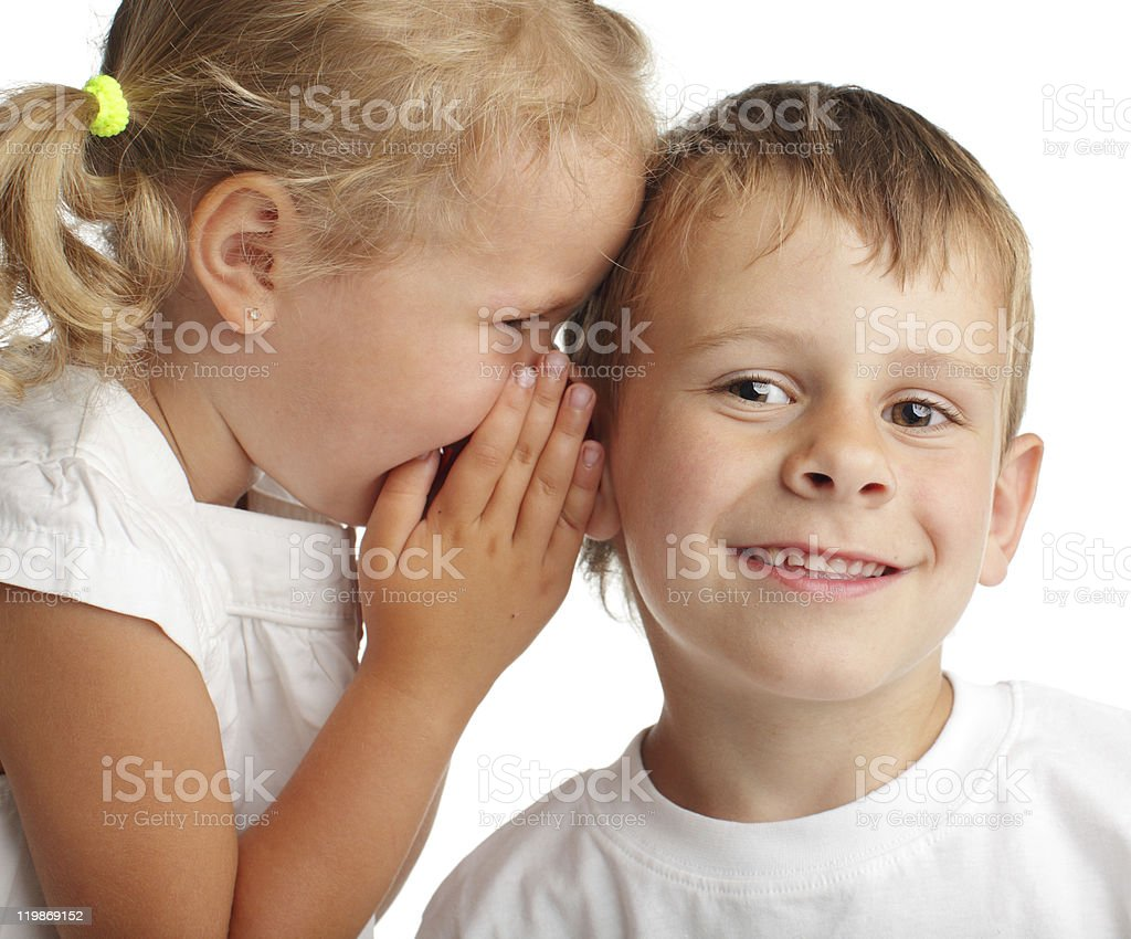 Girl whispers a secret royalty-free stock photo