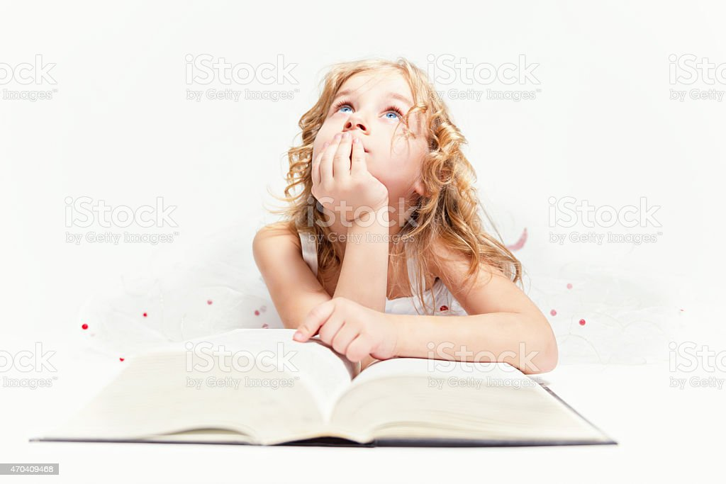 Girl who believes in fairy tales... stock photo
