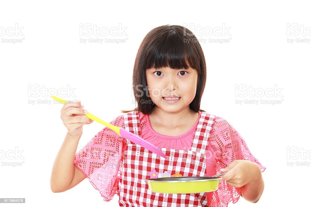 Girl who enjoys cooking stock photo