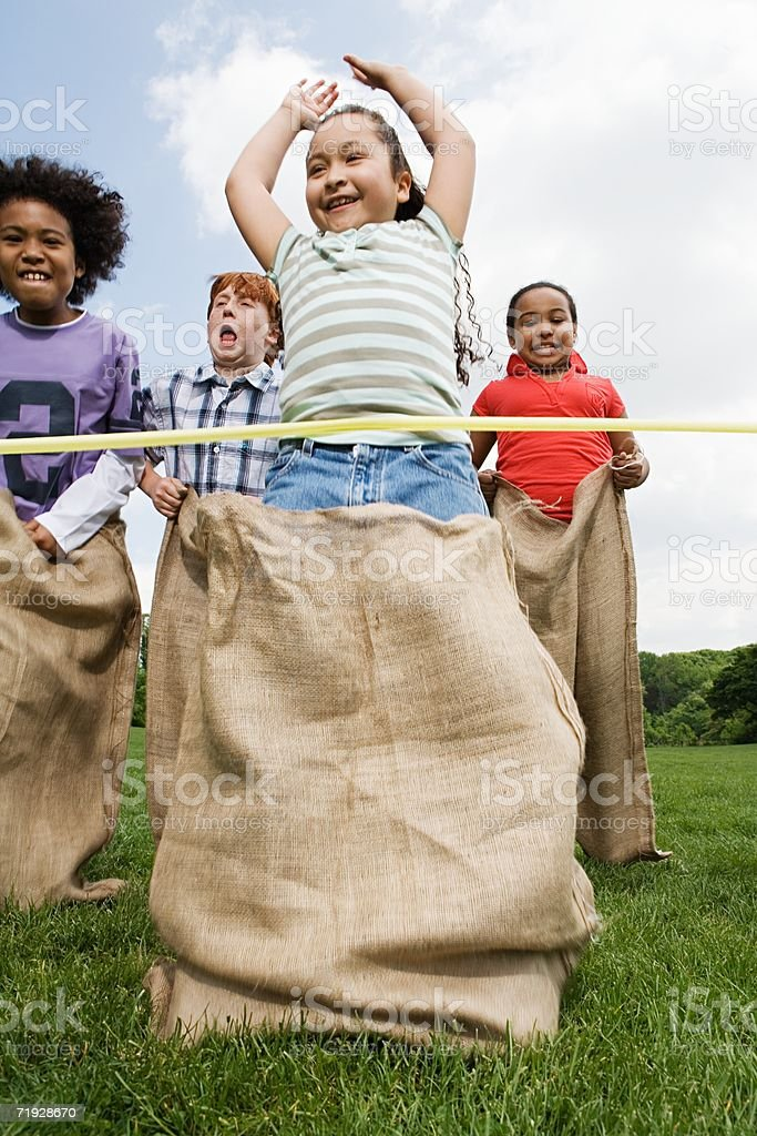 Girl winning sack race stock photo