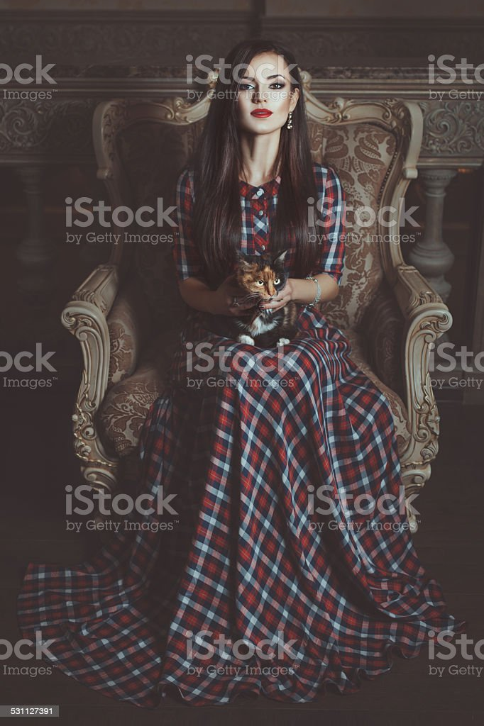 Girl witch with a cat. stock photo