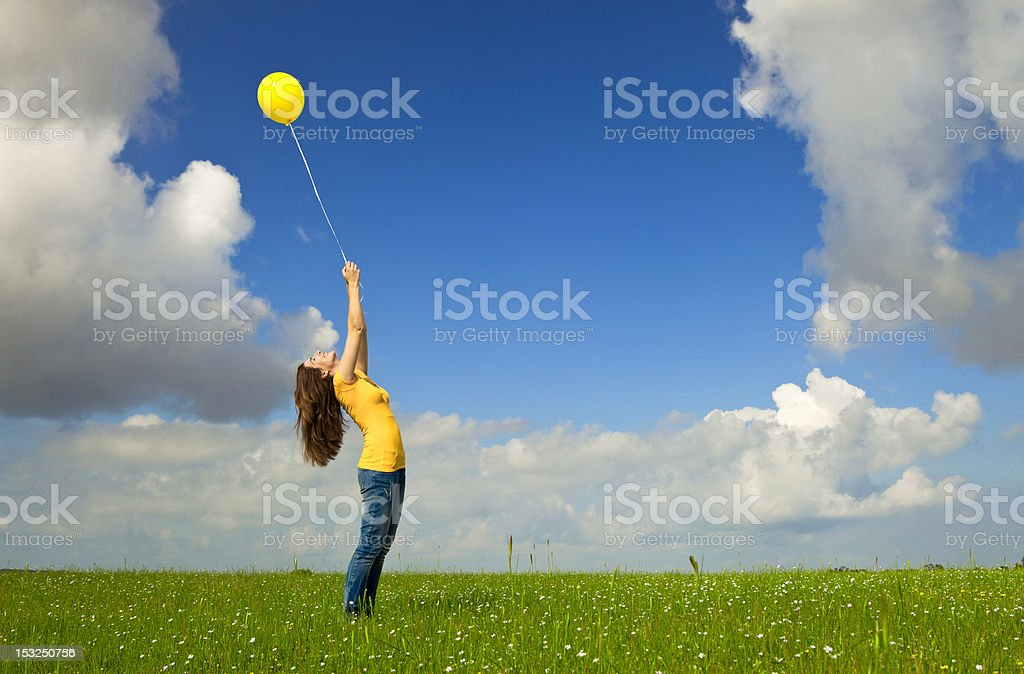 Girl with a balloon royalty-free stock photo