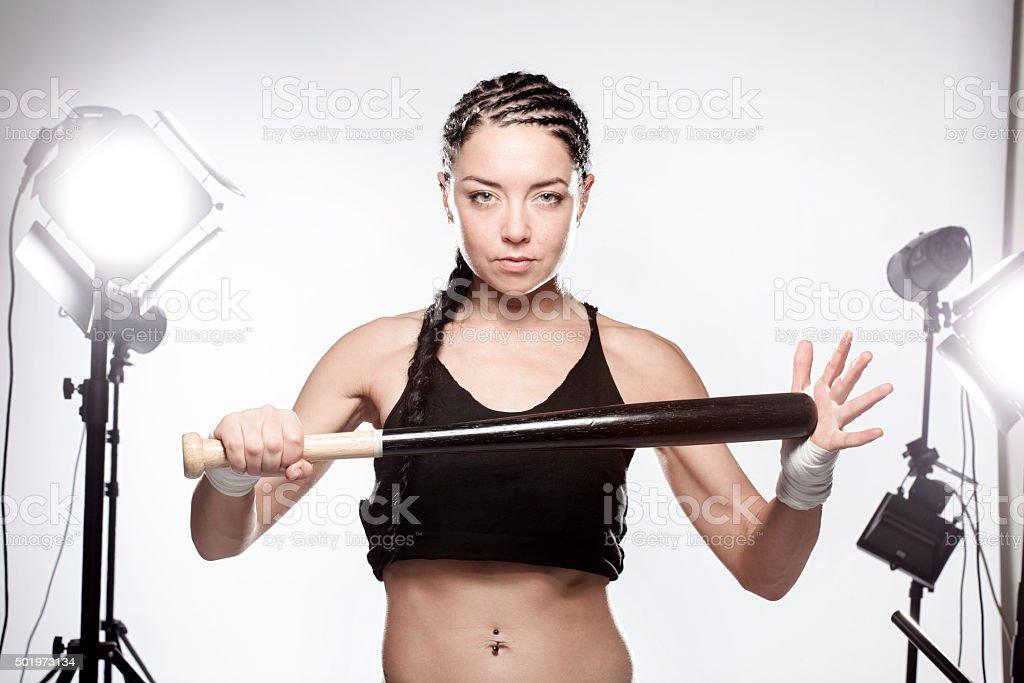 girl with a baseball bat stock photo