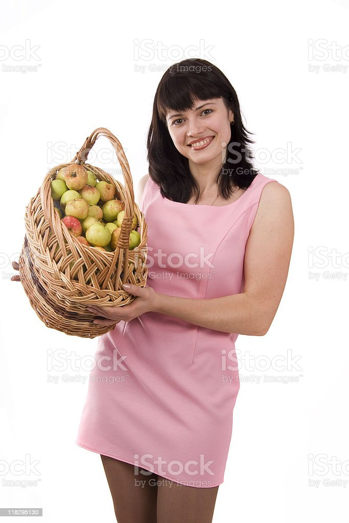 Girl with a basket full of fruits stock photo