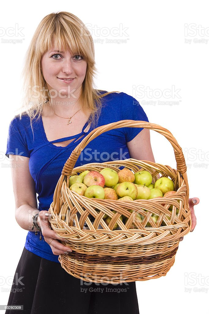 Girl with a basket of apples. stock photo