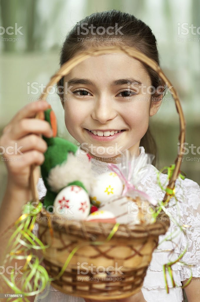 girl with a basket of Easter eggs royalty-free stock photo