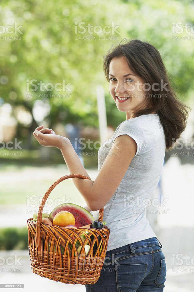 Girl with a basket of fruit and vegetables royalty-free stock photo