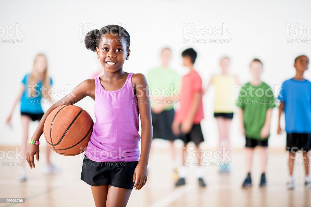 Girl with a Basketball stock photo