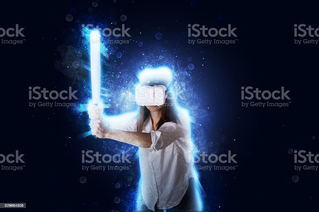 Girl with a bat in VR stock photo