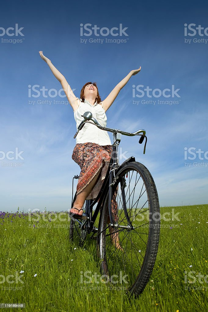 Girl with a bicycle royalty-free stock photo