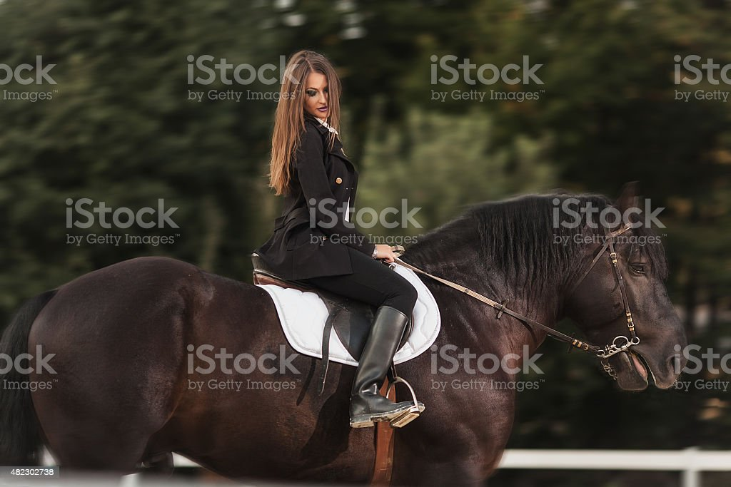 girl with a black horse royalty-free stock photo