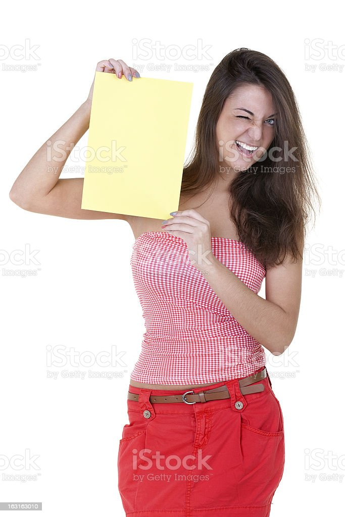 Girl with a blank sheet of paper winks royalty-free stock photo
