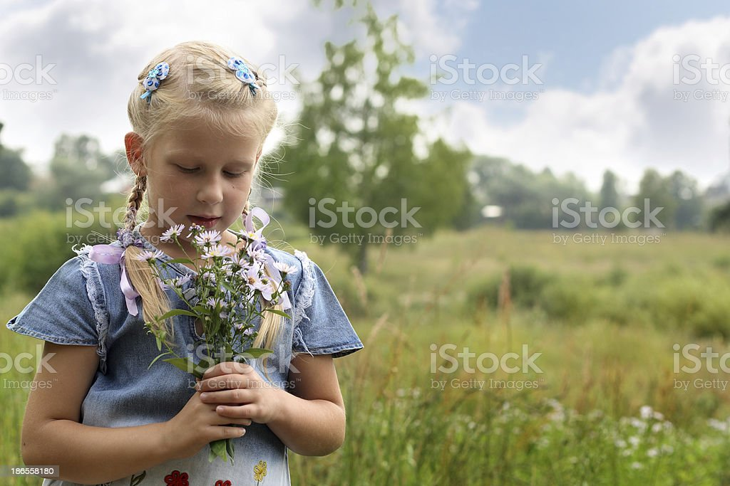 Girl with a bouquet of wild flowers royalty-free stock photo