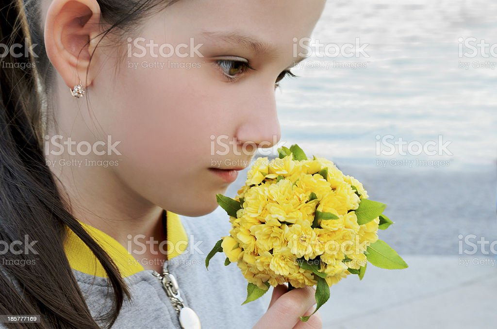 girl with a bouquet of yellow flowers royalty-free stock photo