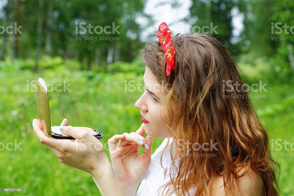 Girl with a bow on her head looking stock photo