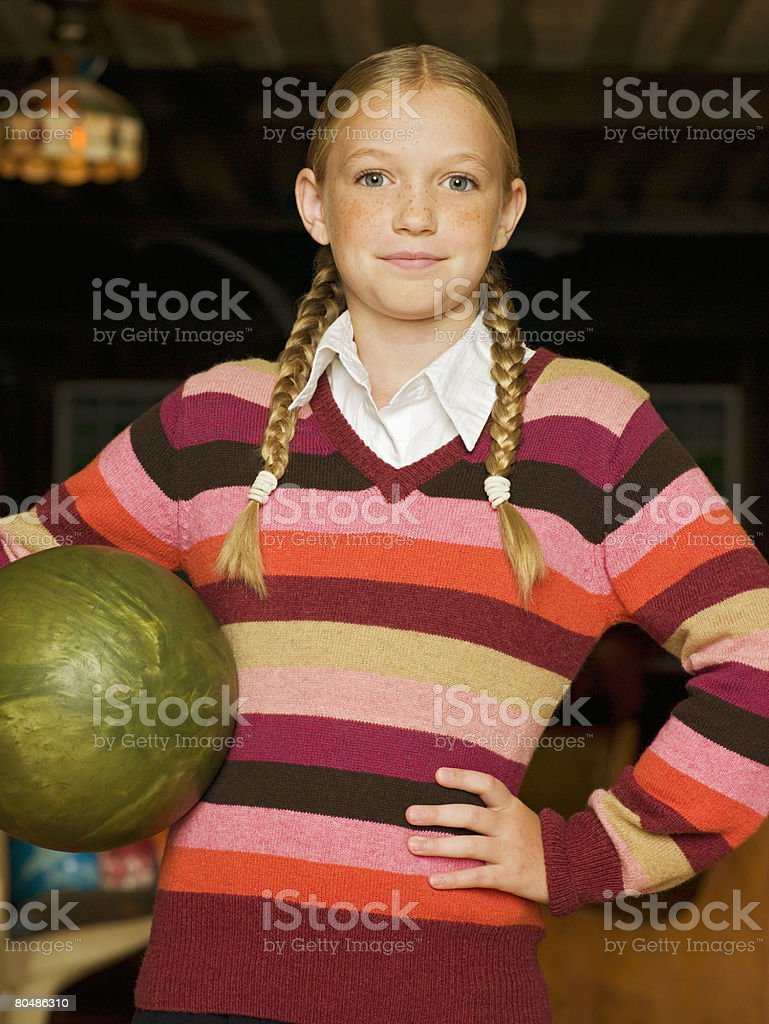 Girl with a bowling ball royalty-free stock photo