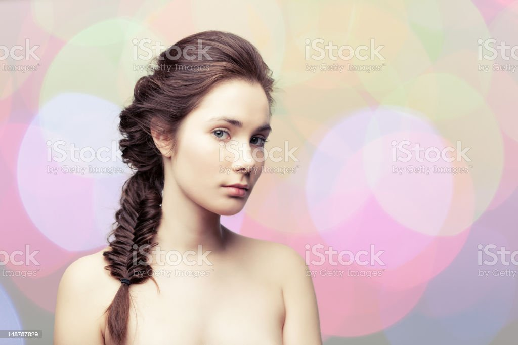 Girl with a braid royalty-free stock photo