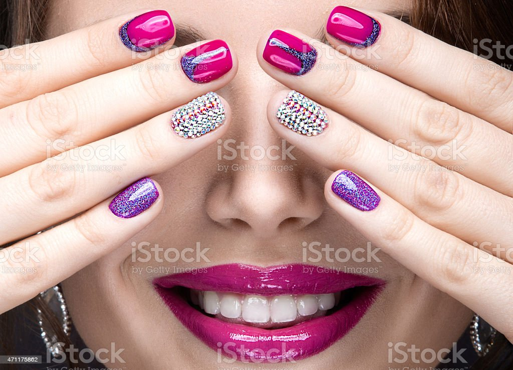 girl with a bright evening make-up and pink manicure stock photo