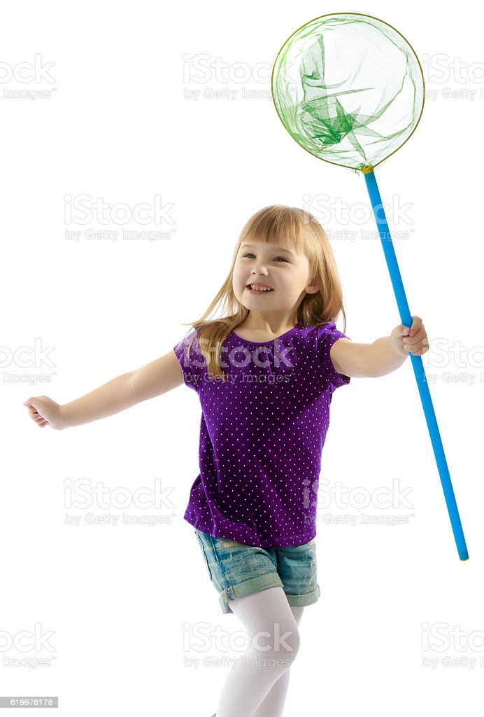 Girl with a butterfly net for catching butterflies stock photo