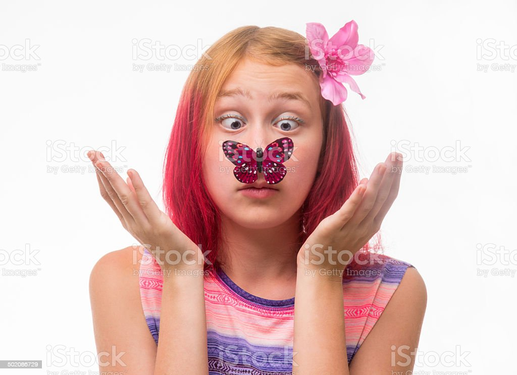 Girl with a butterfly on a nose stock photo