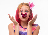 Girl with a butterfly on a nose